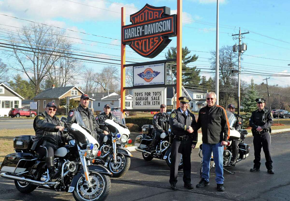 Albany Police Department traffic cops pick up the departments new motorcycles at Spitzie's Motorcycle Center on Thursday Dec. 10, 2015 in Colonie, N.Y. (Michael P. Farrell/Times Union)