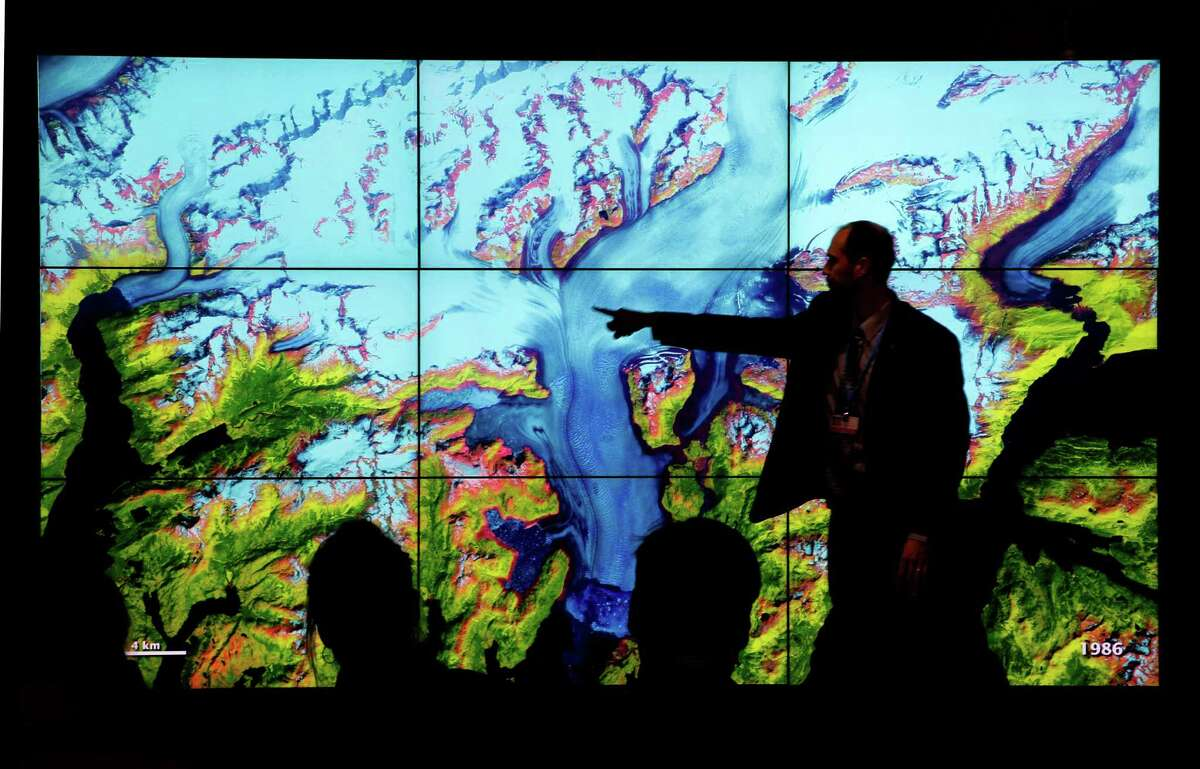 People visit the U.S. pavilion at the United Nations climate conference in Paris. (AP Photo/Christophe Ena)