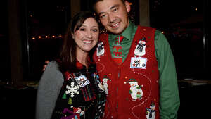 Lori York and Danial Carlson were at the Young Professionals Organization holiday happy hour at The Grill in Beaumont Thursday. Attendees donned their ugly holiday sweaters and brought along a children's toy donation to join in the appetizers and cocktails. Photo taken Thursday, December 10, 2015 Kim Brent/The Enterprise