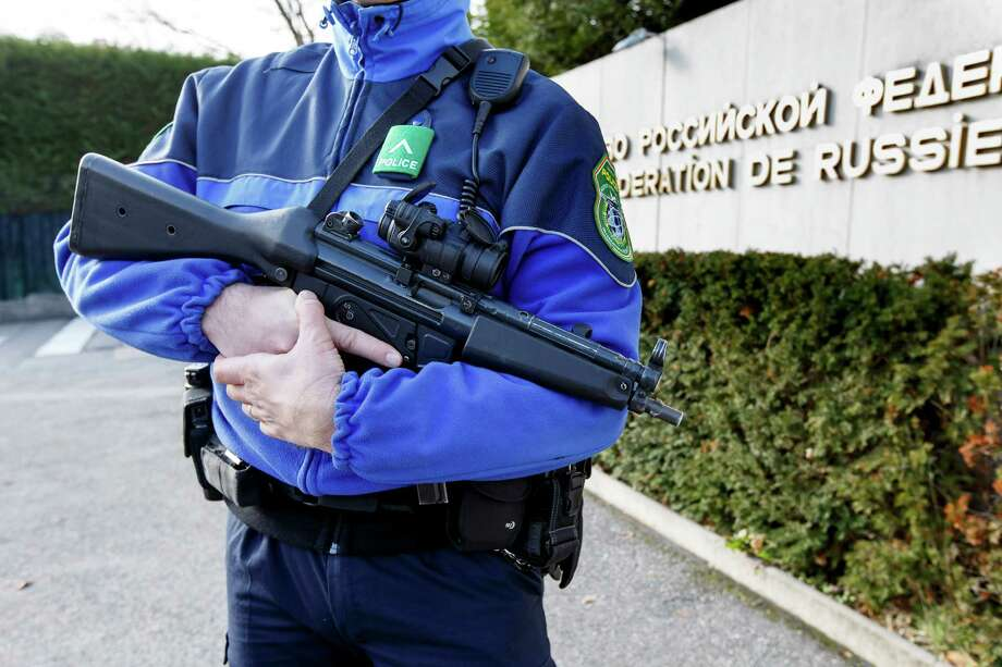 "A Swiss police officer controls the area in front of the Russian mission in Geneva, Switzerland, Thursday, Dec. 10, 2015. Geneva police were ""actively searching"" for suspects in connection with an investigation into the Paris attacks last month, Swiss security officials said Thursday. (Salvatore Di Nolfi/Keystone via AP) Photo: Salvatore Di Nolfi, SUB / KEYSTONE"