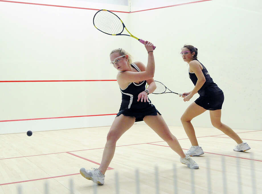 Convent's Madison Miles, left, hits against Greenwich Academy's Claire Aube in the squash match between host Convent of the Sacred Heart and Greenwich Academy on Thursday. Aube stepped up to No. 1 and won 3-0. Photo: Bob Luckey Jr. / Hearst Connecticut Media / Greenwich Time