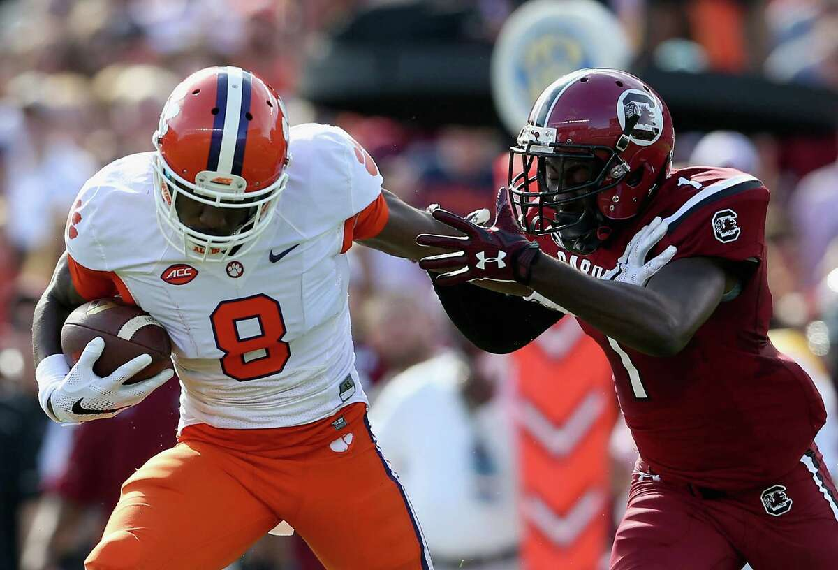 COLUMBIA, SC - NOVEMBER 28: Deon Cain #8 of the Clemson Tigers tries to get away from Deebo Samuel #1 of the South Carolina Gamecocks during their game at Williams-Brice Stadium on November 28, 2015 in Columbia, South Carolina. (Photo by Streeter Lecka/Getty Images) ORG XMIT: 585798127