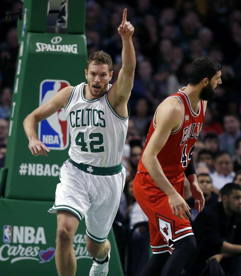 Boston Celtics' David Lee (42) celebrates a basket beside Chicago Bulls' Nikola Mirotic (44) during the second quarter of an NBA basketball game in Boston, Wednesday, Dec. 9, 2015. The Celtics won 105-100. Photo: Michael Dwyer, Associated Press
