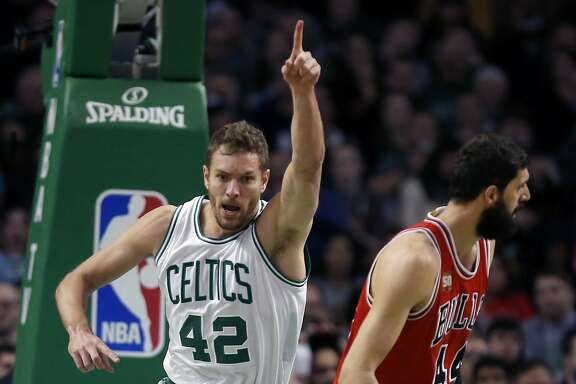 Boston Celtics' David Lee (42) celebrates a basket beside Chicago Bulls' Nikola Mirotic (44) during the second quarter of an NBA basketball game in Boston, Wednesday, Dec. 9, 2015. The Celtics won 105-100. (AP Photo/Michael Dwyer)