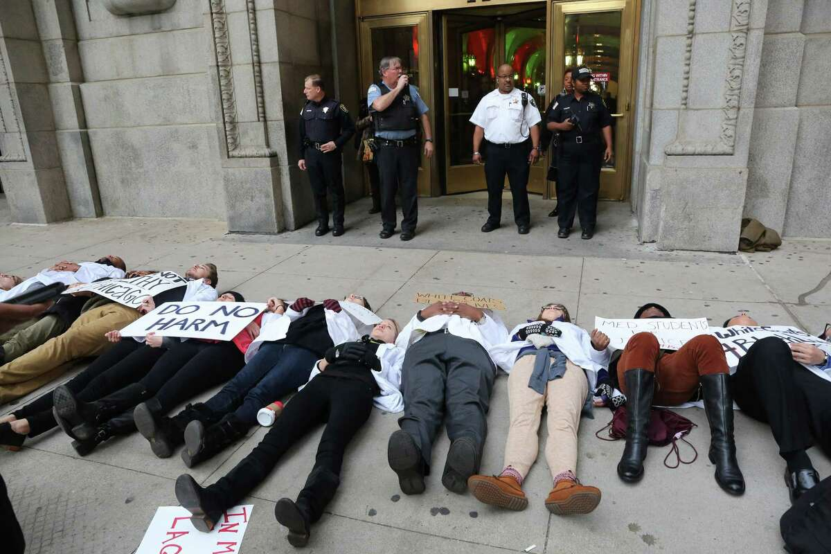 Dozens of medical students from various Chicago student associations stage a