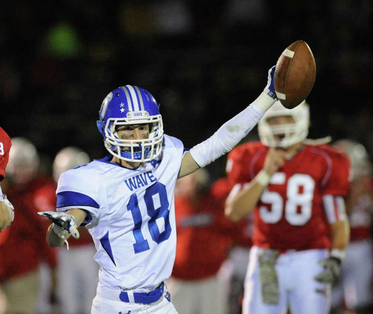 Tyler Grant (18) High school football game between Darien High School and Greenwich High School at Greenwich, Friday night, Sept. 19, 2014. Darien defeated Greenwich, 33-26.