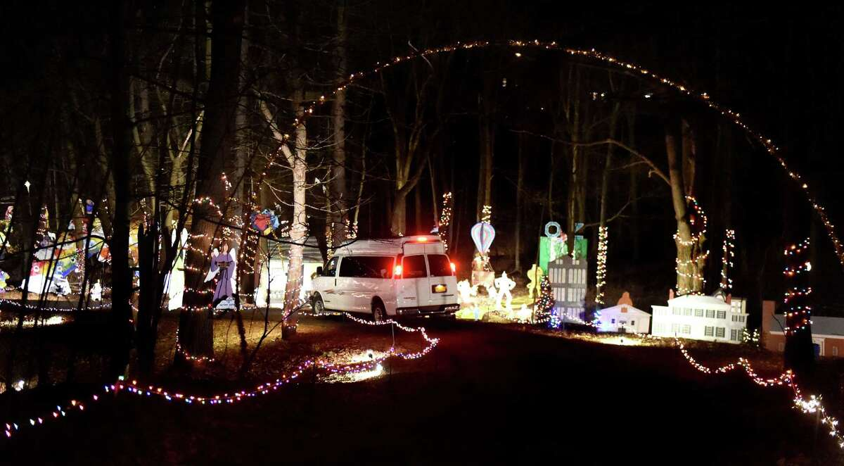 A carload of spectators drives through the 17th annual Light up the Sky with the Marching Rams holiday light display on Thursday, Dec. 10, 2015, at 154 Brookside Ave. in Amsterdam, N.Y. The show runs through Dec. 23 from 6:30 to 9 p.m., weather permitting. The cost is $5 per vehicle with all proceeds benefitting the Amsterdam High marching band. (Cindy Schultz / Times Union)