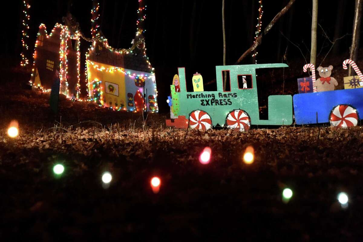 Original holiday displays in the 17th annual Light up the Sky with the Marching Rams holiday light display on Thursday, Dec. 10, 2015, at 154 Brookside Ave. in Amsterdam, N.Y. The show runs through Dec. 23 from 6:30 to 9 p.m., weather permitting. The cost is $5 per vehicle with all proceeds benefitting the Amsterdam High marching band. (Cindy Schultz / Times Union)