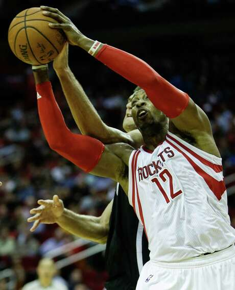Rockets center Dwight Howard totaled a mere nine field-goal attempts in this week's back-to-back games at Brooklyn and Washington. Photo: Brett Coomer, Staff / © 2015 Houston Chronicle