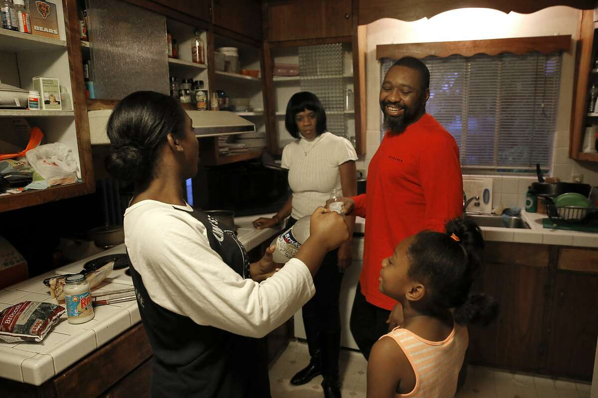 Bruce Williams with his wife Yvette and two of his three daughters Corrine, 14 and Ava, 7 at their Concord, Calif., home on Thursday December 10, 2015. Bruce has battled cancer recently and now the cancer has returned.