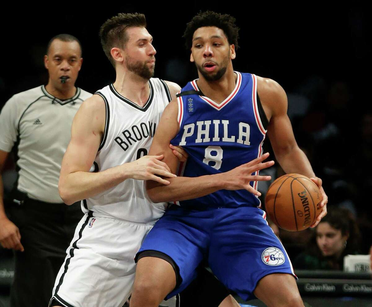Brooklyn Nets' Andrea Bargnani (9) defends Philadelphia 76ers' Jahlil Okafor (8) during the second half of an NBA basketball game Thursday, Dec. 10, 2015, in New York. The Nets won 100-91. (AP Photo/Frank Franklin II) ORG XMIT: NYFF105