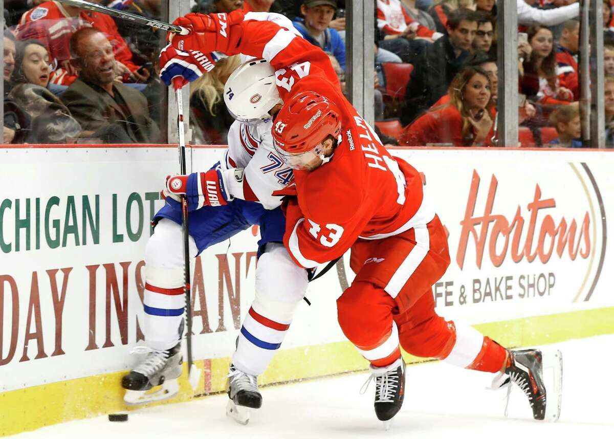 Detroit Red Wings center Darren Helm (43) battles with Montreal Canadiens defenseman Alexei Emelin (74) for the puck in the second period of an NHL hockey game Thursday, Dec. 10, 2015 in Detroit. (AP Photo/Paul Sancya) ORG XMIT: MIPS107