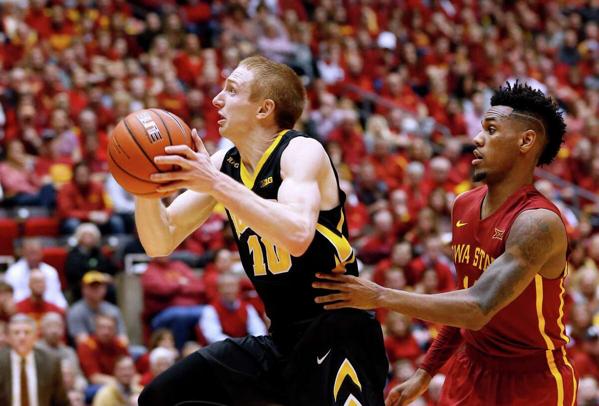 AMES, IA - DECEMBER 10: Mike Gesell #10 of the Iowa Hawkeyes takes a shot as Monte Morris #11 of the Iowa State Cyclones defends in the second half of play at Hilton Coliseum on December 10, 2015 in Ames, Iowa. Iowa State defeated Iowa 83-82. (Photo by David Purdy/Getty Images) ORG XMIT: 587448475