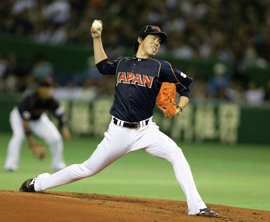 The Astros are trying to decide whether to put in a bid on Japanese pitcher Kenta Maeda. Photo: Toru Takahashi, STF / AP
