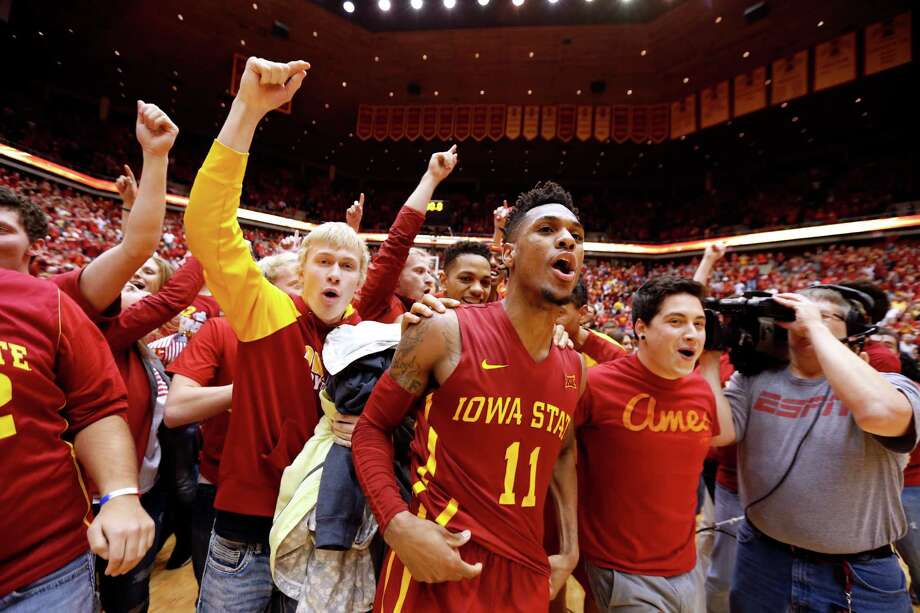 Iowa State's Monte Morris (11) celebrates with fans after he sank the winning basket to defeat Iowa 83-82 on Thursday in Ames, Iowa. Photo: David Purdy, Stringer / 2015 Getty Images