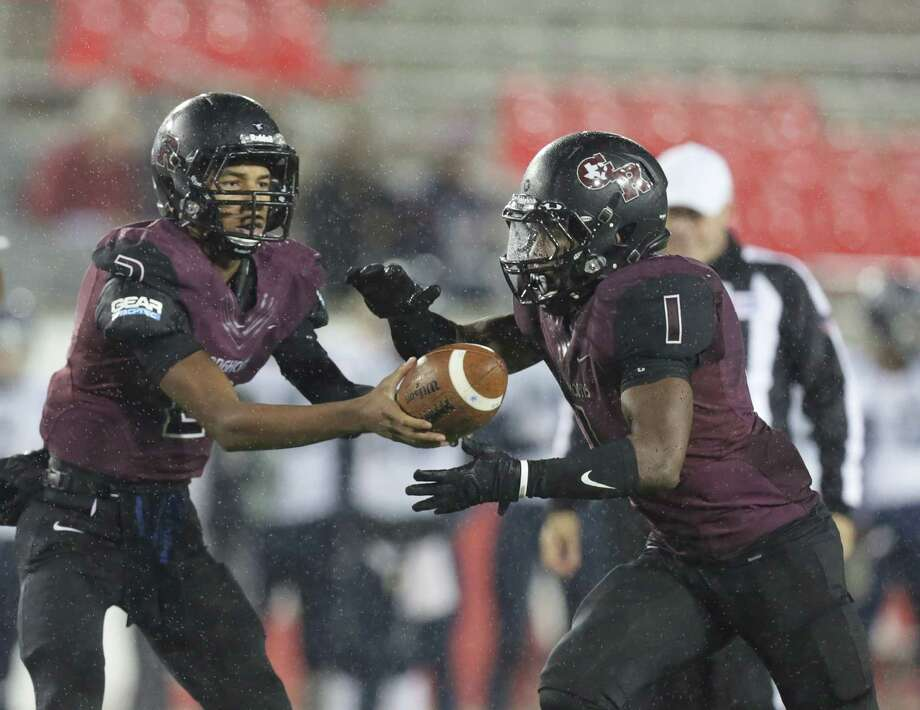 Quarterback Antonio Jackson, left, and running back Darius Anderson have helped George Ranch reach the state semifinals in the school's fourth varsity season. Photo: Jon Shapley, Staff / © 2015  Houston Chronicle