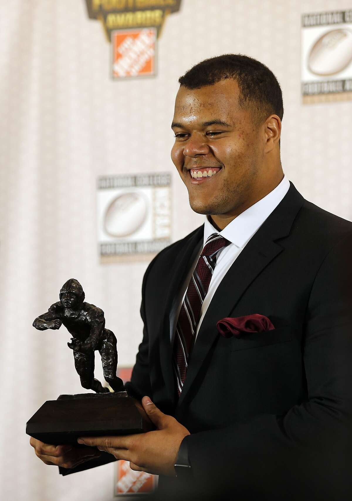 Stanford's Joshua Garnett poses after winning the Outland trophy for the being the nation's best interior lineman at the College Football Hall of Fame , Thursday, Dec. 10, 2015, in Atlanta. (AP Photo/John Bazemore)