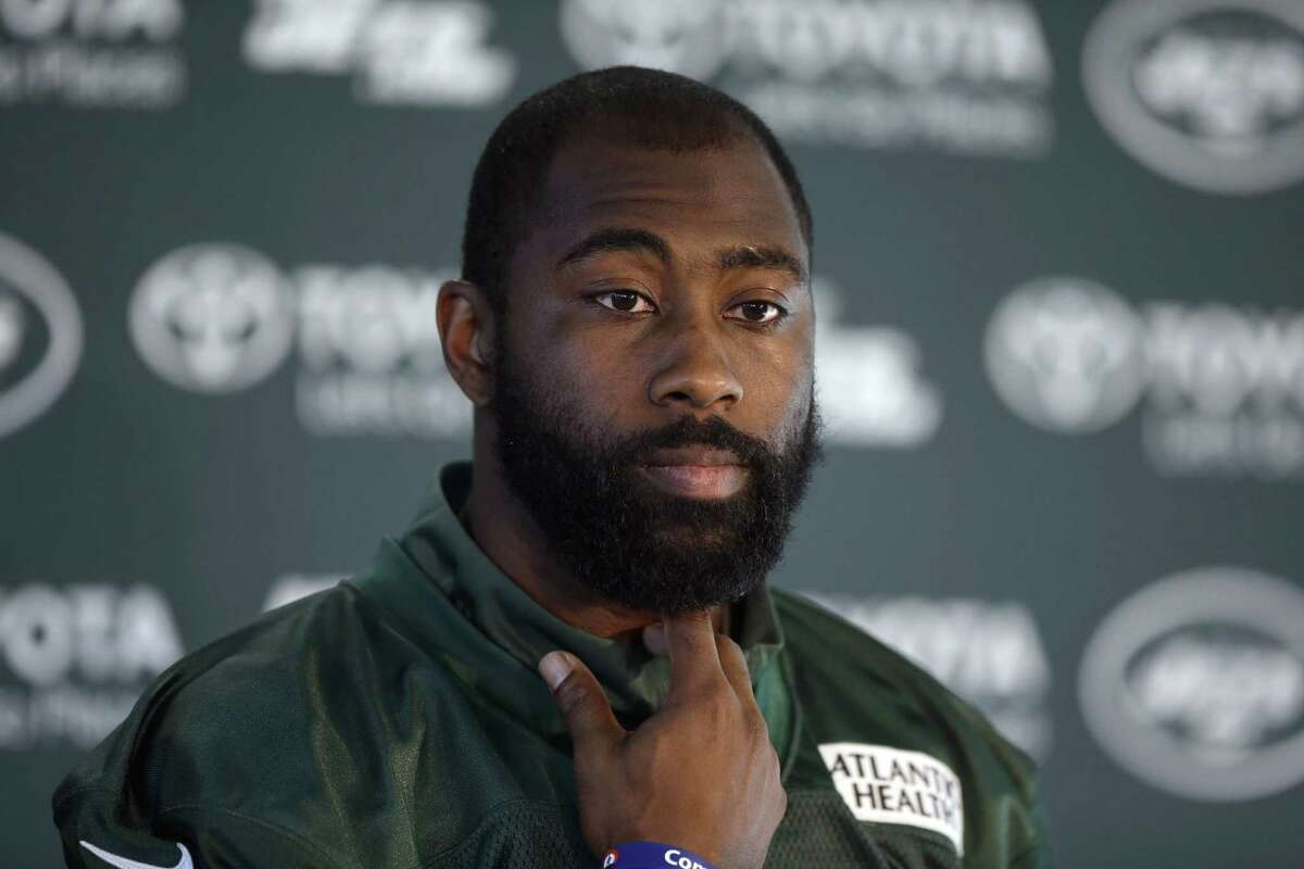 FILE - In this Oct. 2, 2015, file photo, New York Jets cornerback Darrelle Revis gives a press conference after an NFL training session at London Irish training ground in south west London. The Jets are taking on Odell Beckham Jr. without Darrelle Revis. Coach Todd Bowles announced Friday, Dec. 4, 2015, that the star cornerback is officially listed as out for the game Sunday because of a concussion. (AP Photo/Matt Dunham, File) ORG XMIT: NY160