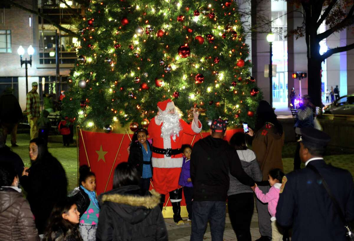 """The Christmas tree on McLevy Green is lit as hundreds of residents watch in downtown Bridgeport, Conn. on Thursday Dec. 10, 2015. Viewers can tune in to the family friendly cable television network this coming holiday season for a film being shot partially in the Park City, called """"Love in the Newsroom."""""""