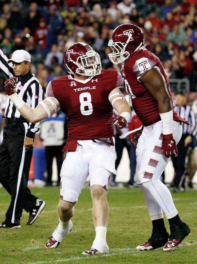 Temple linebacker Tyler Matakevich (8) celebrates his sack with defensive lineman Praise Martin-Oguike (50) during the first half of an NCAA college football game against the Connecticut, Saturday, Nov. 28, 2015, in Philadelphia. (AP Photo/Chris Szagola) Photo: Chris Szagola / Associated Press / FR170982 AP
