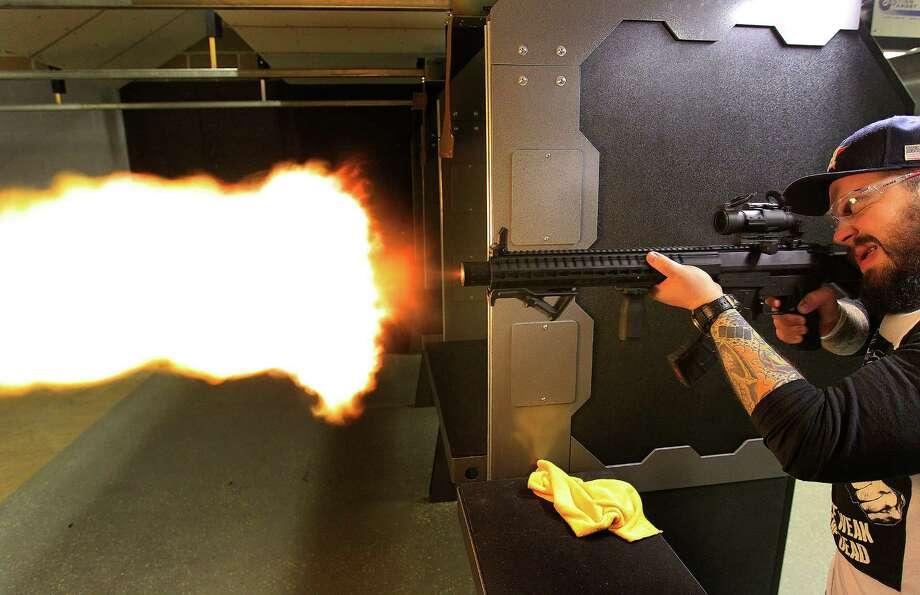 Craig Hlavaty shoots an MK47 at the Liberty Armory, the only gun range inside the 610 Loop, Thursday, Dec. 10, 2015, in Houston. Photo: Mark Mulligan, Houston Chronicle / © 2015 Houston Chronicle