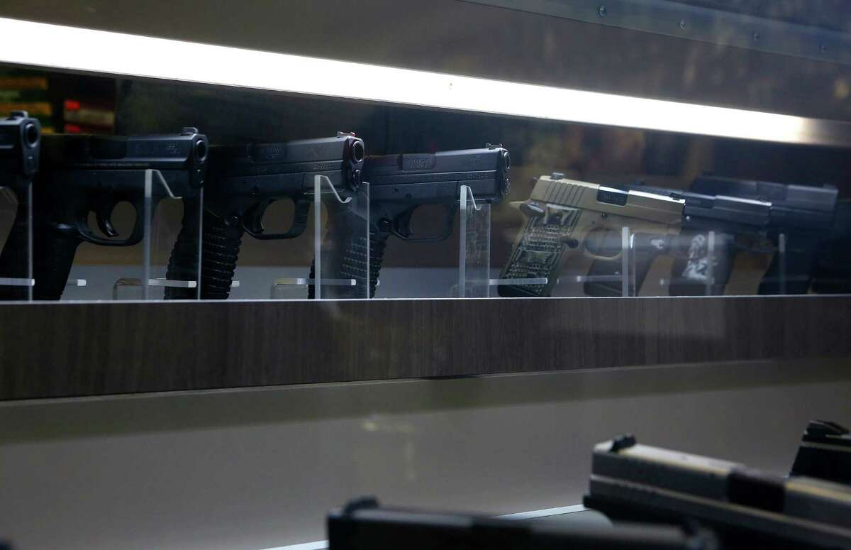 Hand guns are on display at the Liberty Armory, the only gun range inside the 610 Loop, Thursday, Dec. 10, 2015, in Houston.