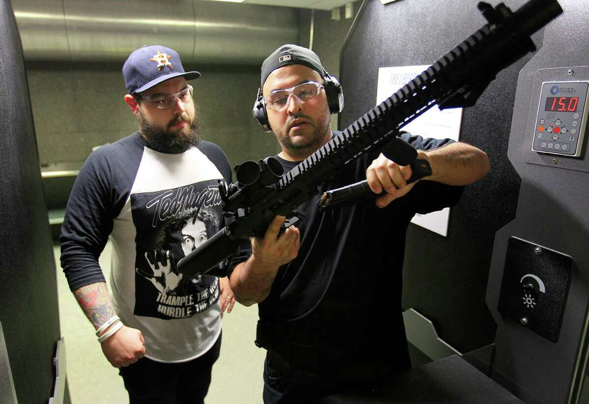 Michael Solis checks out a MK47 with Craig Hlavaty at the Liberty Armory, the only gun range inside the 610 Loop, Thursday, Dec. 10, 2015, in Houston.
