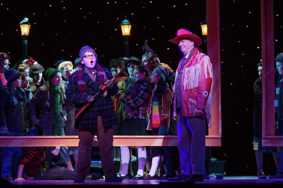 "Estus Stephens as Ralphie & Kevin Cooney as Jean Shepherd in Theatre Under The Stars' production of ""A Christmas Story."" Photo: Bruce Bennett / Bruce Bennett 2015 and beyond"