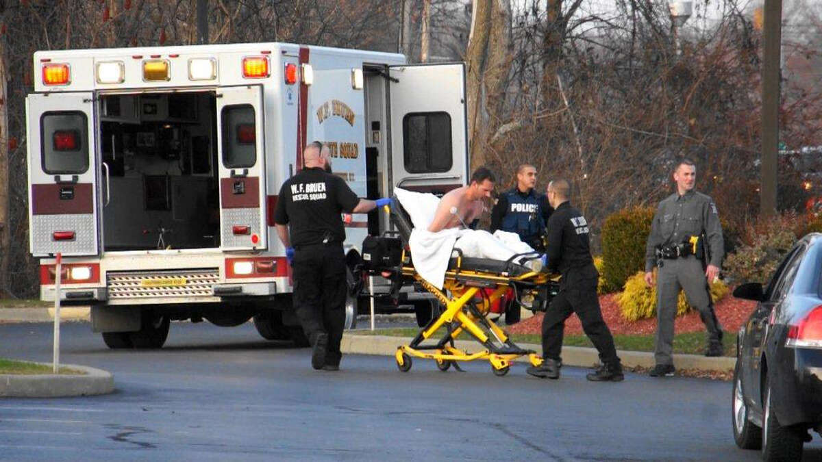 David Agan is taken away by first responders in East Greenbush Thursday, Dec. 10, 2015, following a fatal stabbing at the Valatie Medical Arts Facility. (Martin Miller / Special to the Times Union)
