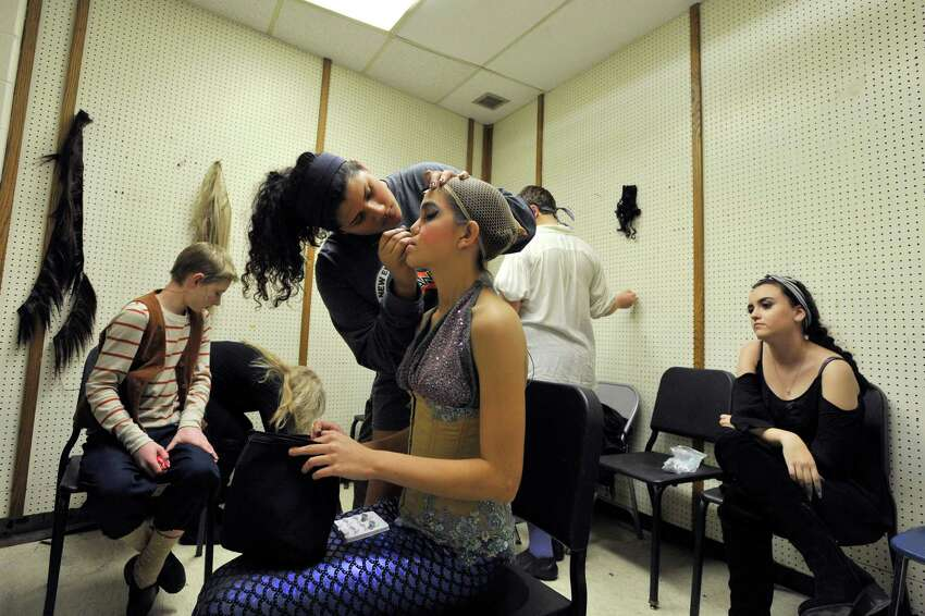 OPENING NIGHT Monica Gonzalez applies the finishing touches on Audrey Molina's makeup before the opening night performance of the All-School Musical