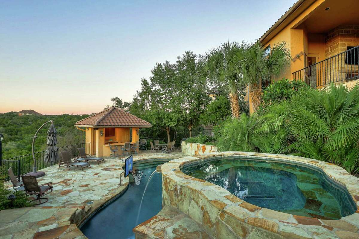 This four-bedroom mansion has a beautiful Mediterranean-style, coming packed with a stunning pool and patio for a mere $1.125 million.