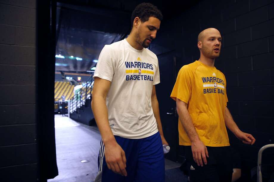 Golden State Warriors' Klay Thompson and head athletic trainer Drew Yoder head to locker room after shootaround at TD Garden in Boston, Massachusetts on Friday, December 11, 2015. Photo: Scott Strazzante, The Chronicle