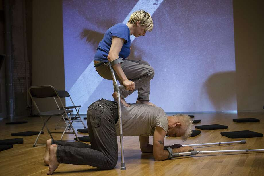 "Claire Cunningham and Jess Curtis perform a hard- to-follow ""The Way You Look (at Me) Tonight."" Photo: Sven Hagolani."