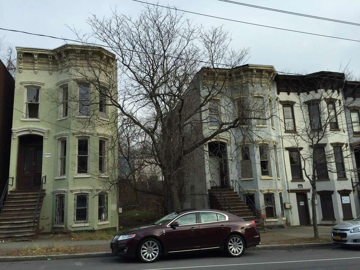 These vacant rowhouses at 315, 311 and 309 Clinton Ave. in Arbor Hill will be among the first five rehabilitated by the Albany County Land Bank in partnership with Habitat for Humanity of the Capital District and the city of Albany. (Jordan Carleo-Evangelist/Times Union)