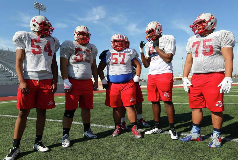 Judson offensive linemen (from left) Mark White, Eligio Gayton, Jakob Alonzo, Terrence Hickman and Isaiah Spears take a break during practice on Dec. 9, 2015. Photo: William Luther /San Antonio Express-News / © 2015 San Antonio Express-News