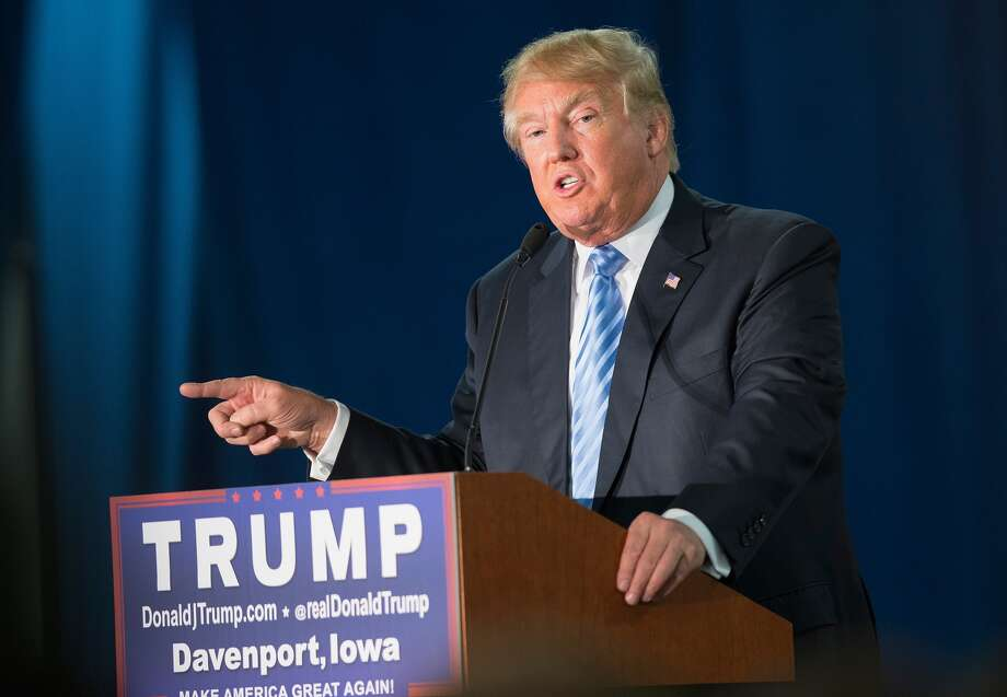 Republican presidential candidate Donald Trump speaks to guests gathered for a campaign event at Mississippi Valley Fairgrounds on December 5, 2015 in Davenport, Iowa. Trump continues to lead the most polls in the race for the Republican nomination for president. (Photo by Scott Olson/Getty Images)