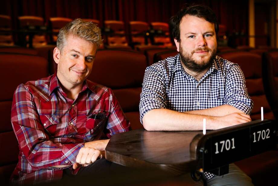 Tim League, CEO of Alamo Drafthouse and Mike Keegan, creative manager, pose for a portrait in the main theater at the Alamo Drafthouse at the New Mission Theater in San Francisco, California on Friday, December 4, 2015. Photo: Gabrielle Lurie, Special To The Chronicle