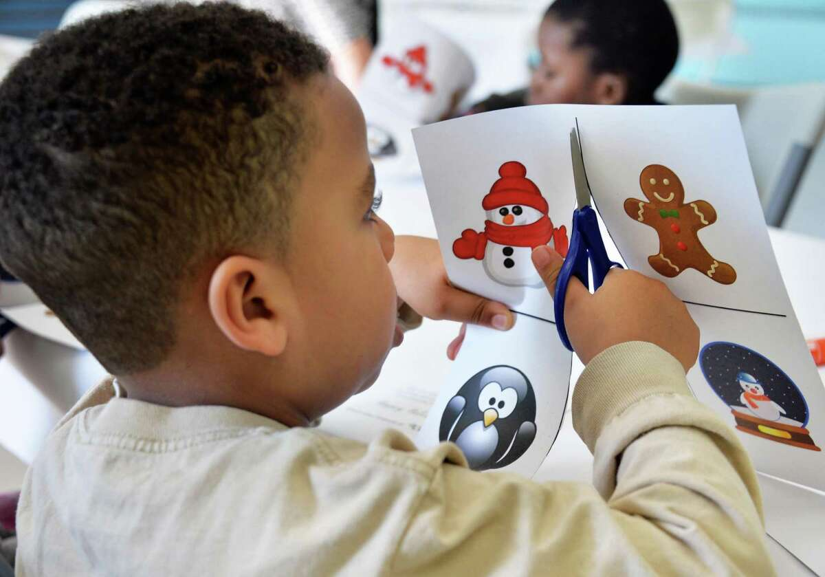 Four-year-old Isaac Lewis and classmates at CEO's Head Start program make holiday cards for service members stationed at Fort Drum and across the country at the Commission on Economic Opportunity's (CEO) Family Resource Center Friday Dec. 11, 2015 in Troy, NY. (John Carl D'Annibale / Times Union)