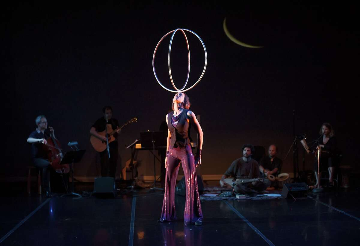 """Coventry & Kaluza 4.jpg In """"Mittens and Mistletoe: A Winter Circus Cabaret,"""" clown Natasha Kaluza manages to keep 50 hula hoops in motion. Sweet Can's family-friendly show continues through Dec. 27 at Dance Mission Theater. Photo by Shoot That Klown"""