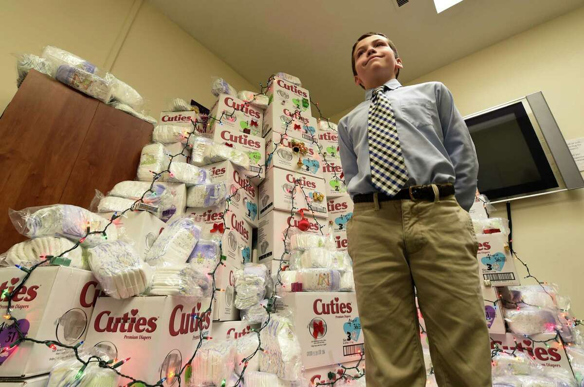 Connor Meigher, 11, student at the Albany Academy worked weekends to raise over $3500 for the homeless stands tall in a display of some of the items that were purchased with his donation to the Homeless and Travelers Aid Society Friday Dec. 11, 2015 in Albany, N.Y. (Skip Dickstein/Times Union)