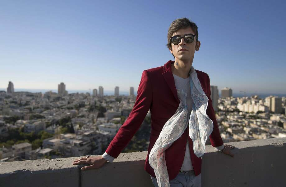 Iranian poet Payam Feili, who celebrates liberation in Tel Aviv, says he escaped to Turkey last year when the Iranian government's threats against him and his family became unbearable. Photo: Dan Balilty, Associated Press