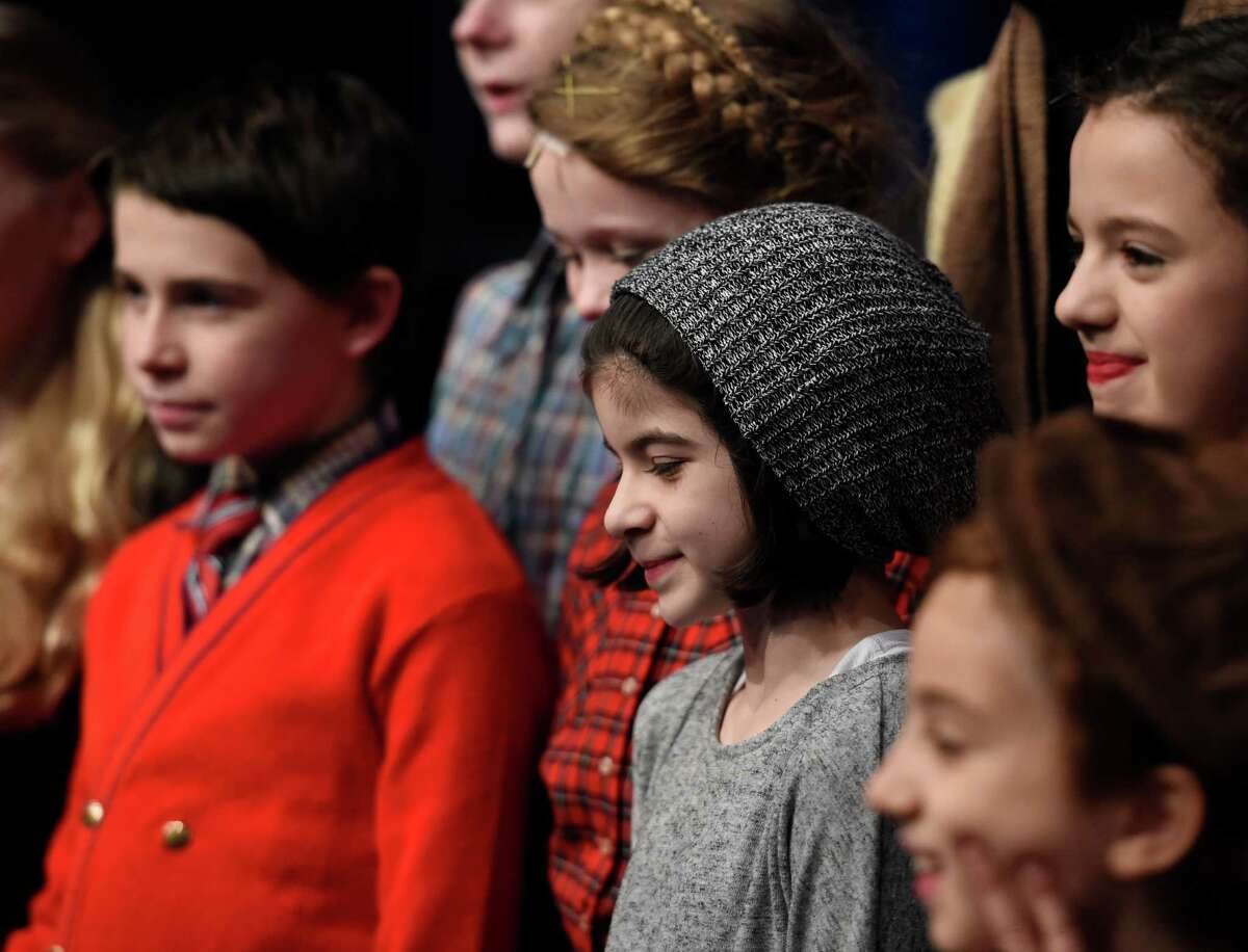 Broadway actor Gabriella Pizzolo, center, visits Capital Repertory Theater on Friday Dec. 11, 2015 to her friends who are appearing in production of