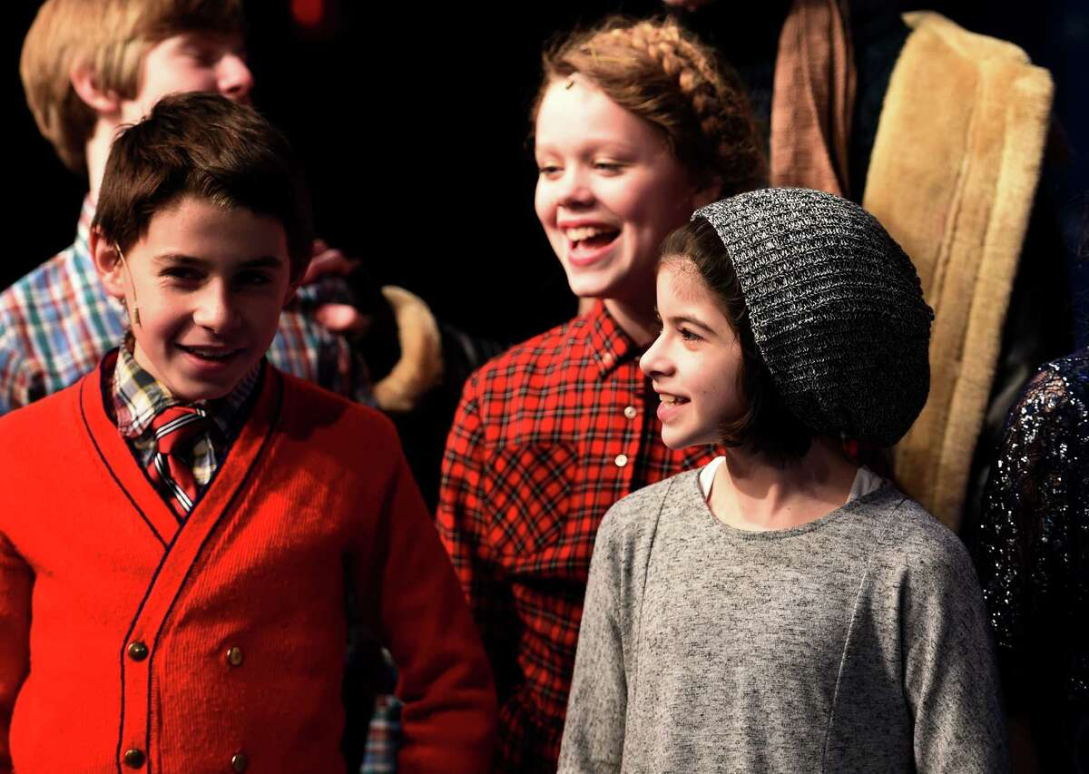 Broadway actor Gabriella Pizzolo, in hat, visits Capital Repertory Theater on Friday Dec. 11, 2015 to her friends who are appearing in production of