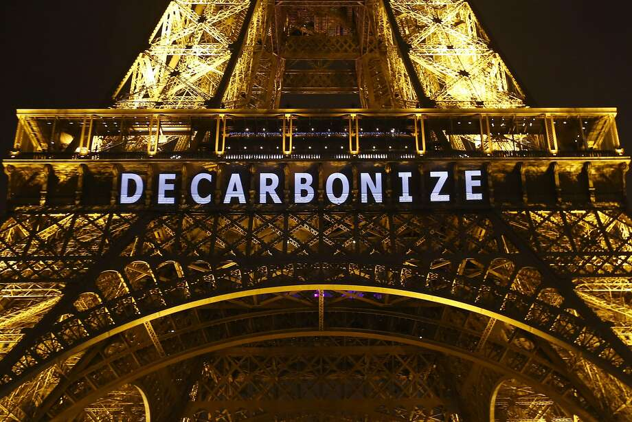 """The message """"Decarbonize"""" appears on the Eiffel Tower in Paris during the U.N. Climate Change Conference. Negotiators hope to reach a final agreement Saturday. Photo: Francois Mori, Associated Press"""