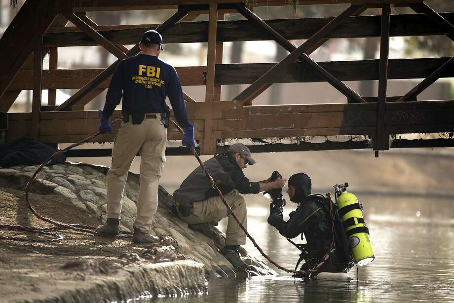 An FBI dive team prepares to search Lake Seccombe in San Bernardino for evidence in the massacre. Leads suggest the shooters had been in the area. Photo: Jae C. Hong, Associated Press