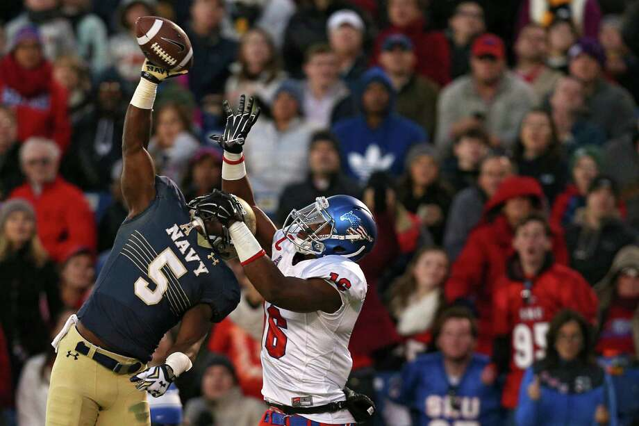 Cornerback Quincy Adams (5) of the Navy Midshipmen breaks up a pass intended for wide receiver Courtland Sutton of the SMU Mustangs in the first half at Navy-Marine Corps Memorial Stadium on Nov. 14, 2015 in Annapolis, Maryland. Photo: Patrick Smith /Getty Images / 2015 Getty Images
