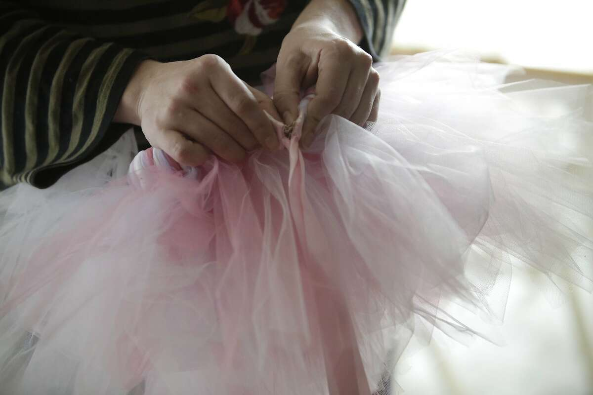 Xana Cook-Milligan shows off one the tutus that she used to make but is unable to anymore since injuring her wrist at work on Tuesday, December 8, 2015 in Pacifica, Calif.