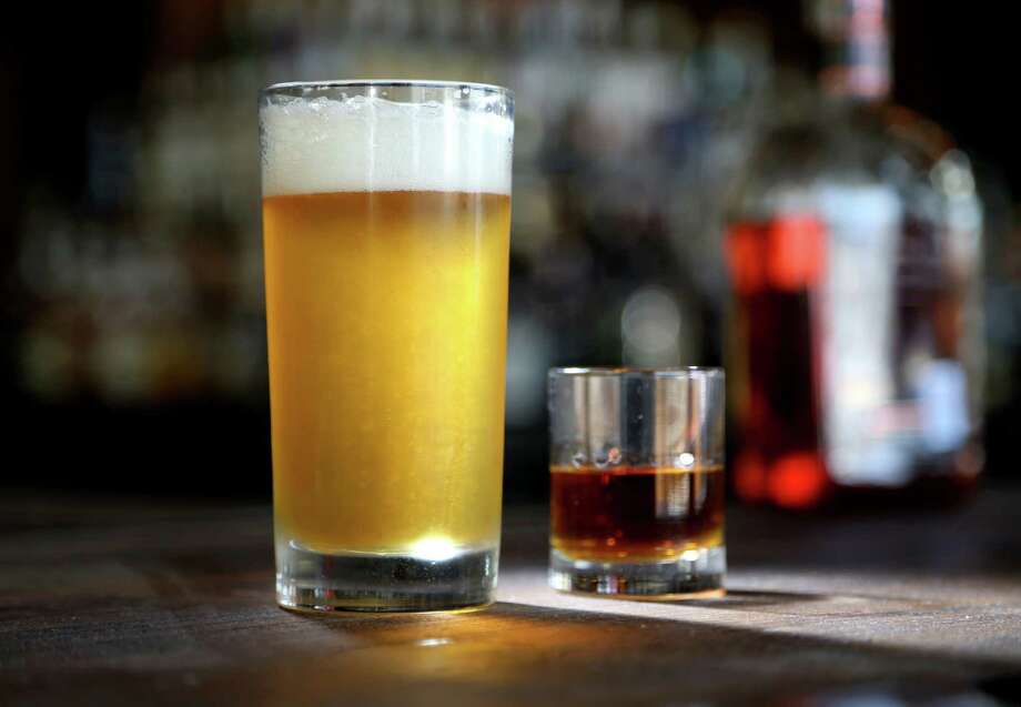Eight Row Flint's beer and a shot include Boulevard Smokestack Tank 7 beer alongside a shot of Woodford Reserve Distillers Select 8 Row Flint proprietary bourbon. Photo: Gary Coronado, Staff / © 2015 Houston Chronicle