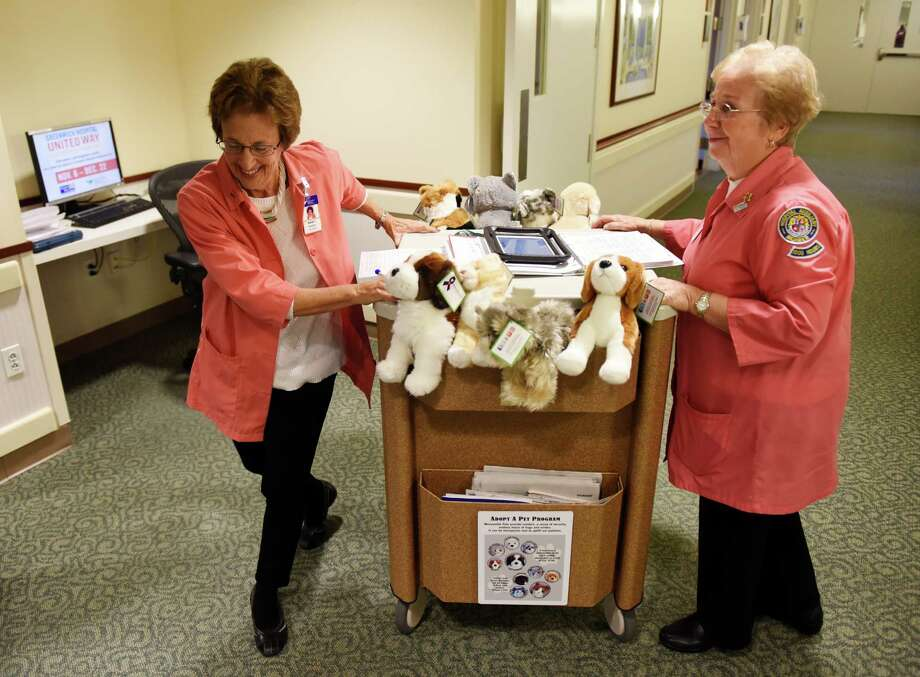 Volunteers Nancy Donahue, left, and Corrine Maurer keep track of inventory after helping a patient with the kindness cart at Greenwich Hospital in Greenwich, Conn. Thursday, Dec. 3, 2015.  Greenwich Hospital partnered with Adopt a Pet to launch the kindness cart initiative.  Twice a week, volunteers help Alzheimer's and dementia patients enjoy their hospital stay more by providing practical items, games, music and stuffed animals from the kindness cart. Photo: Tyler Sizemore / Hearst Connecticut Media / Greenwich Time