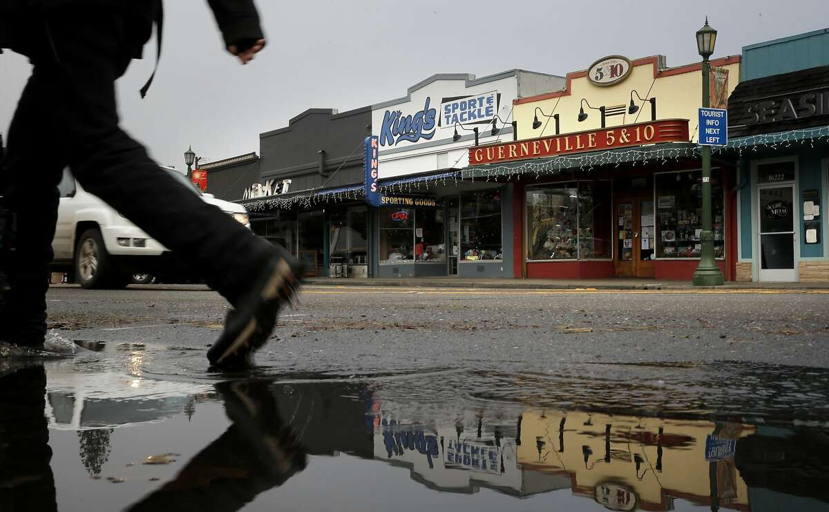 Downtown Guerneville, Calif., where puddles from an overnight rainstorm clogged the gutters through town, along the Russian River on Friday December 11, 2015. The lower Russian River area (Guerneville, Monte Rio, Hacienda et al) is better prepared for flooding today than it was in 1997, the last time a big El Nino flood hit.